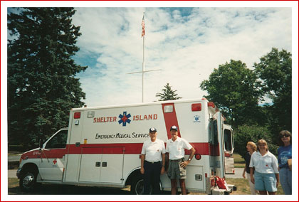 photo of Ben Jones and Bud Foxi and Diane Kilb n front of Ambulance 16